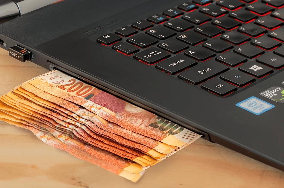 laptop with cash
